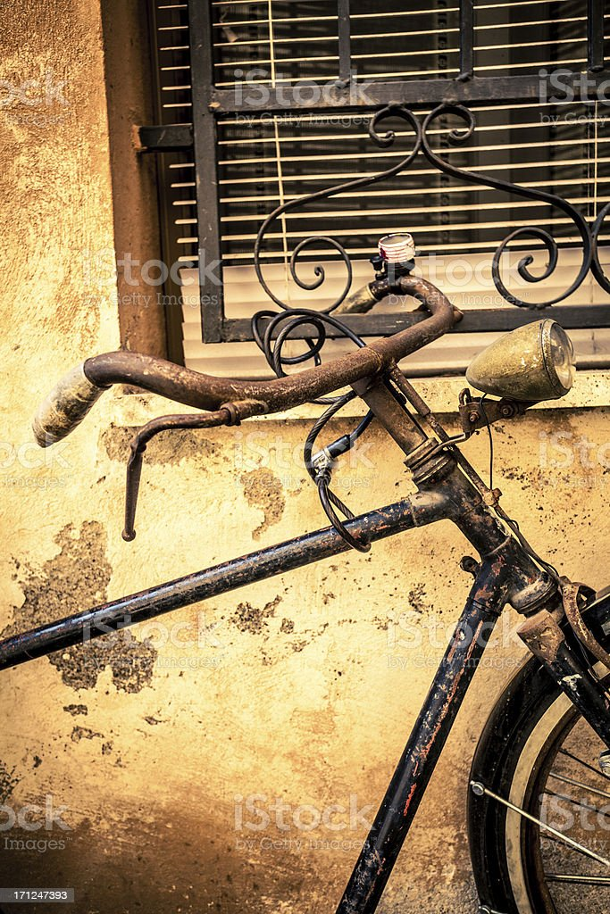 Vintage Bycicle leaning on the Wall, Italy royalty-free stock photo