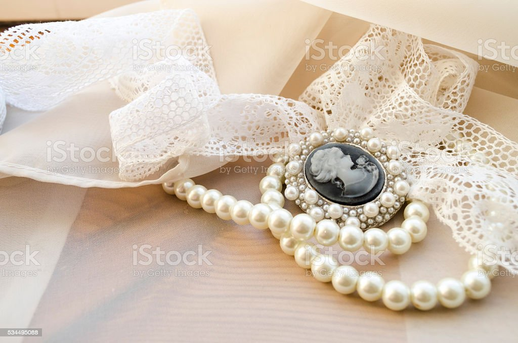 vintage cameo, pearls and lace stock photo