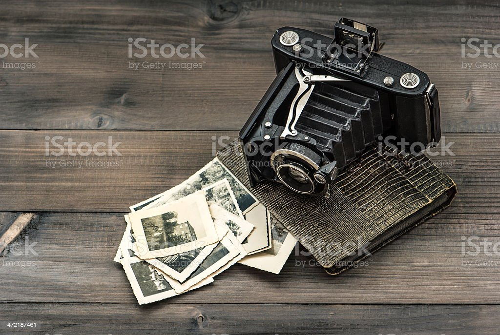 vintage camera and album with old photos stock photo