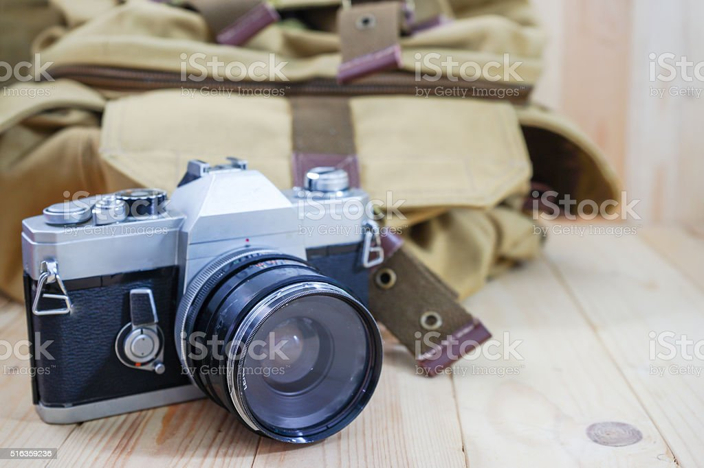 vintage camera and brown bag stock photo