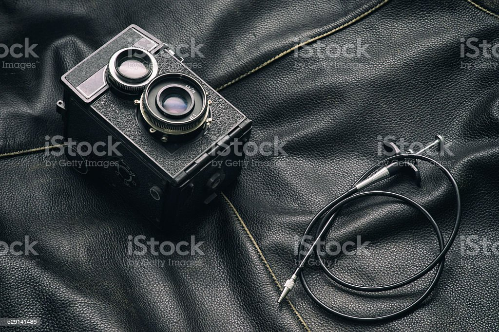 Vintage camera and cable release stock photo
