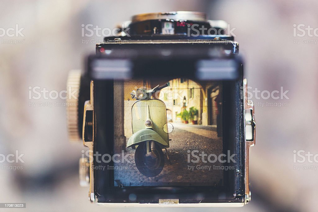 Vintage Camera and Retro Scooter stock photo