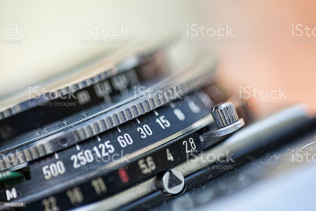Vintage Camera Detail Showing Shutter Speed and Aperture Numbers stock photo