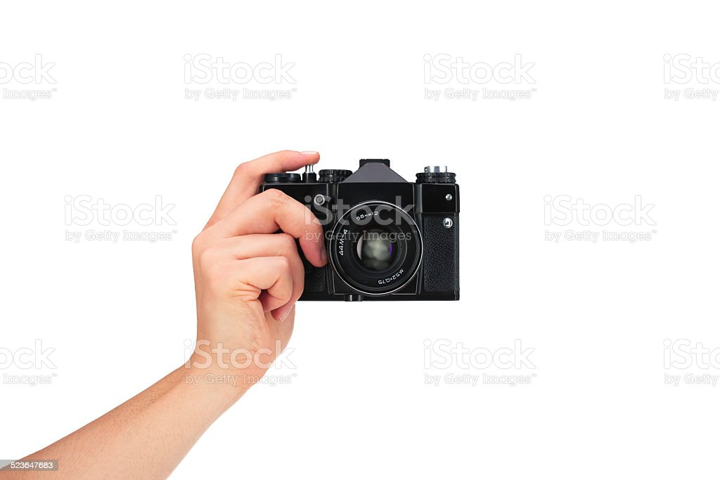 Vintage camera in hand on white background stock photo