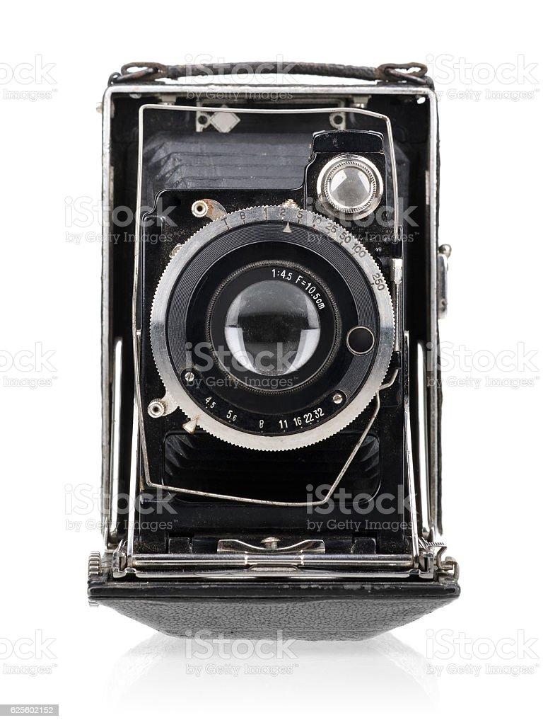Vintage camera isolated on white background. stock photo