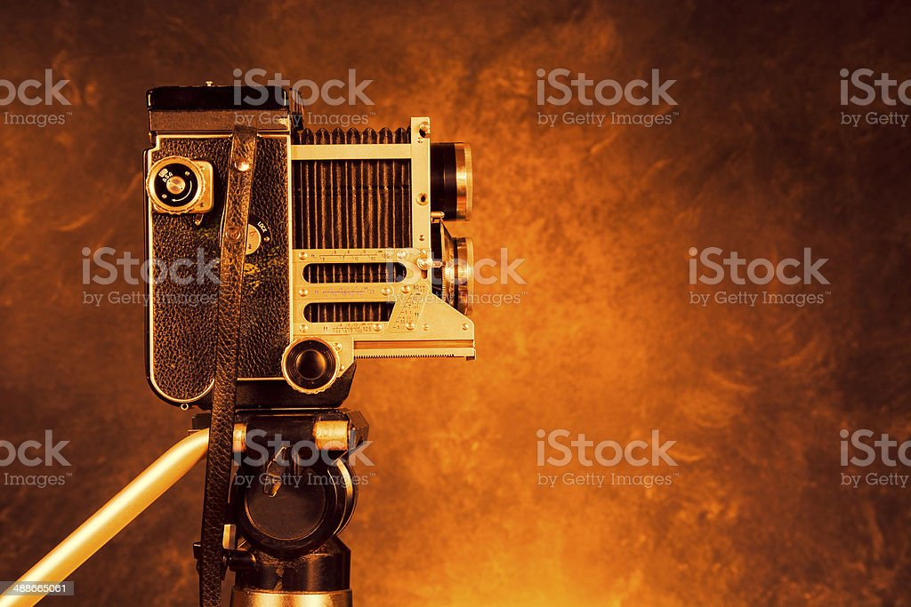 Vintage camera on a tripod stock photo
