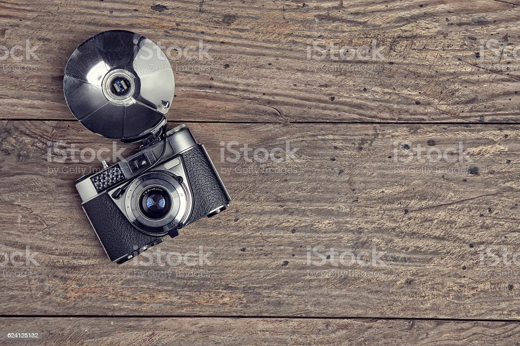 Vintage camera on a wooden background stock photo