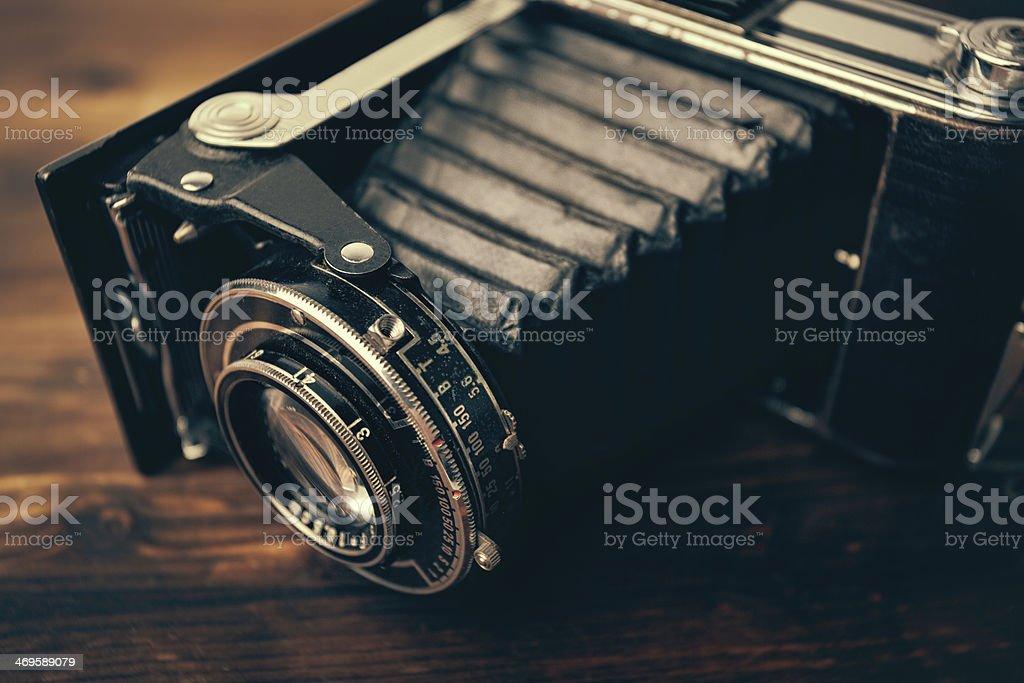 Vintage camera on wooden background stock photo