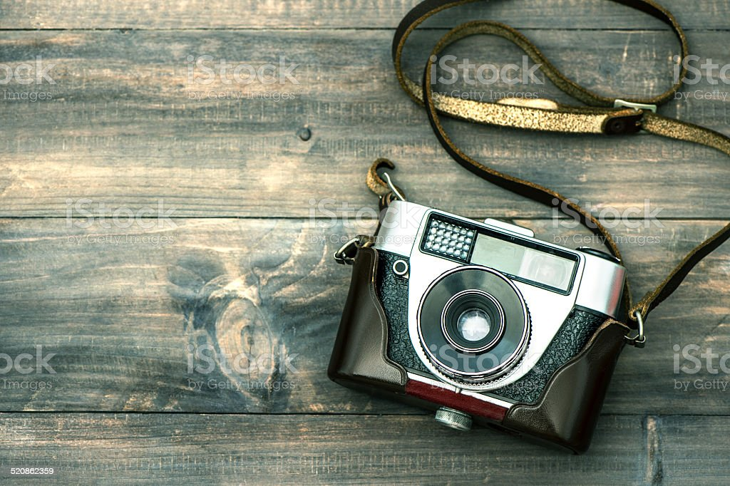 Vintage camera on wooden background. Retro style toned picture stock photo