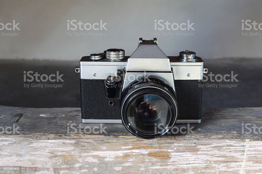 Vintage camera on wooden timber stock photo