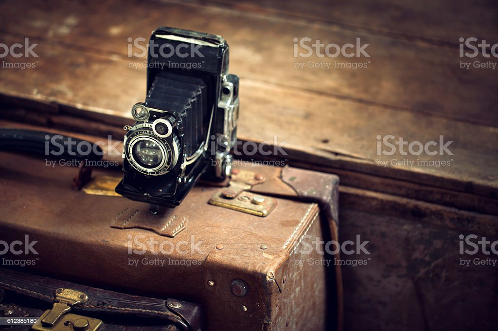 Vintage camera with suitcases stock photo