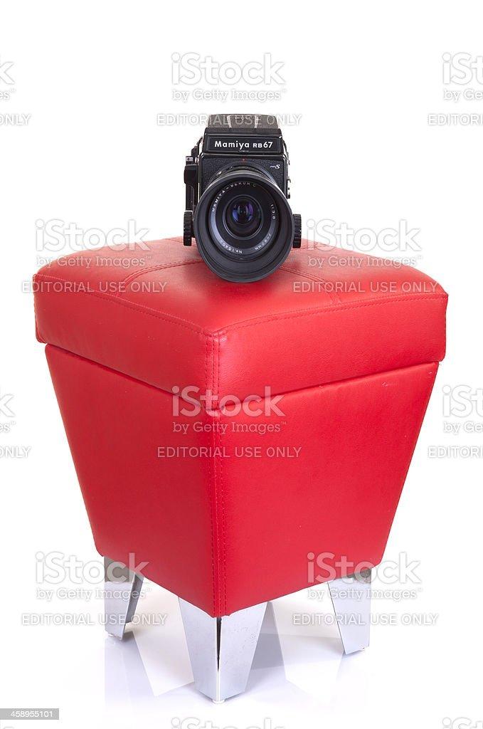 vintage camera,mamiya RB67 on pouffe royalty-free stock photo