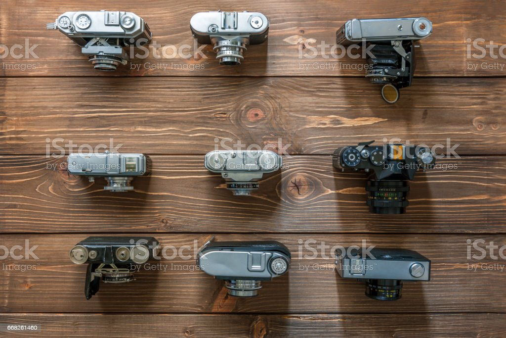 Vintage cameras and lenses on wooden background stock photo