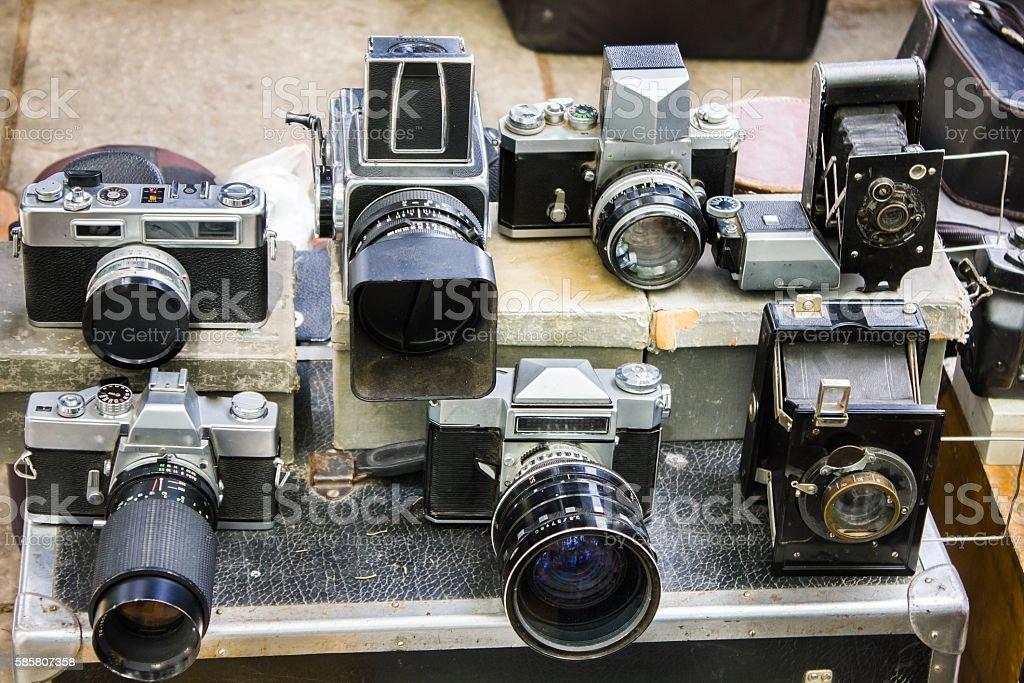 vintage cameras at flea market stock photo