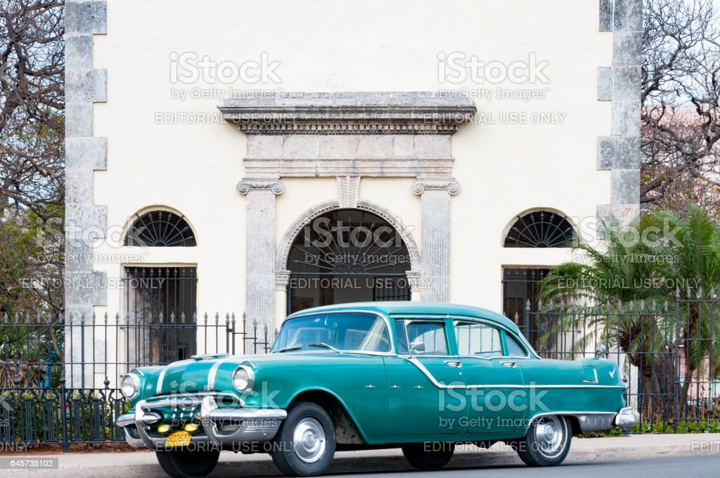 Vintage car and building in Old Havana, Cuba stock photo