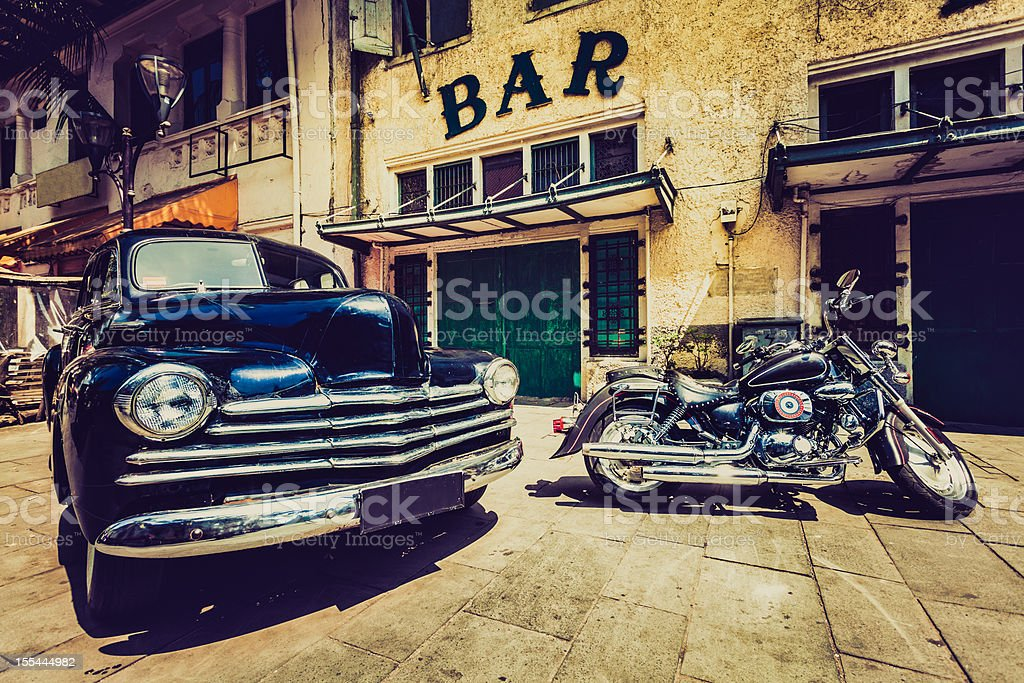 Vintage Car (Chevrolet) and Motorbike in Jakarta, Indonesia royalty-free stock photo