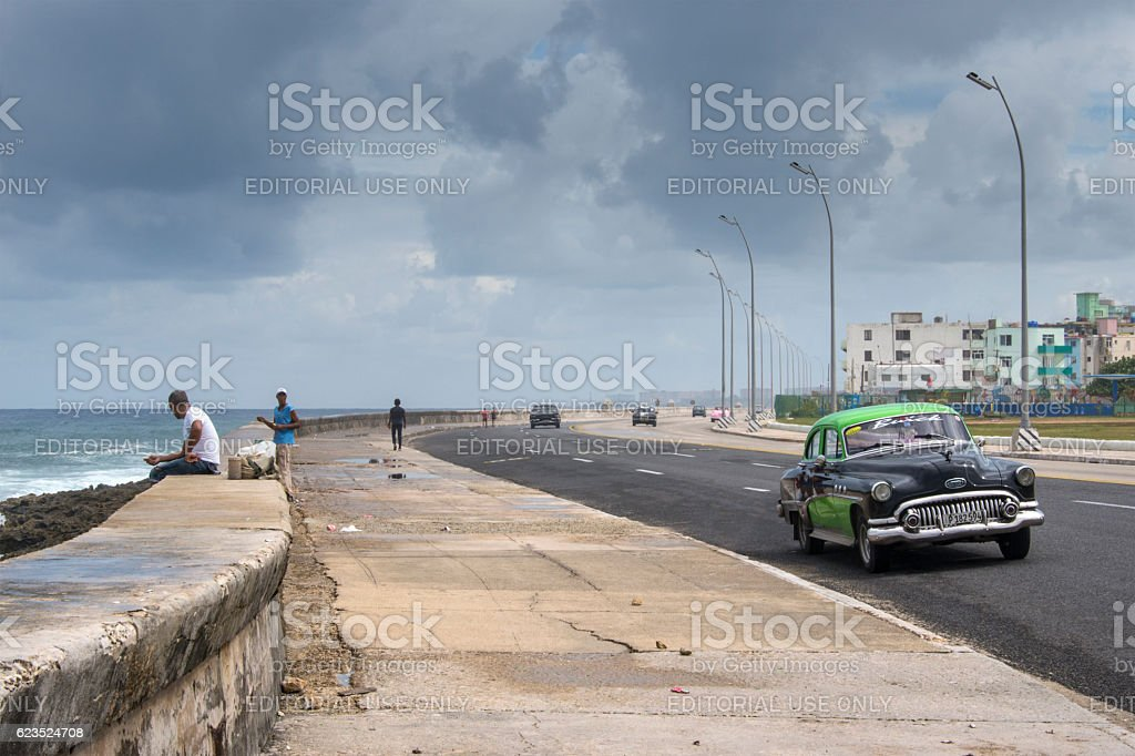 Vintage car at the Malecon boulevard in Havana stock photo