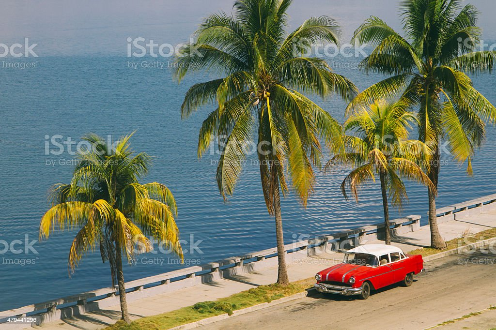 Vintage car by Caribbean sea stock photo