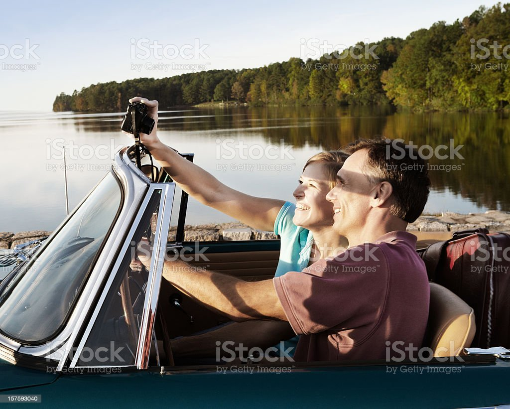 Vintage Car Couple Taking Selfie by Lake royalty-free stock photo