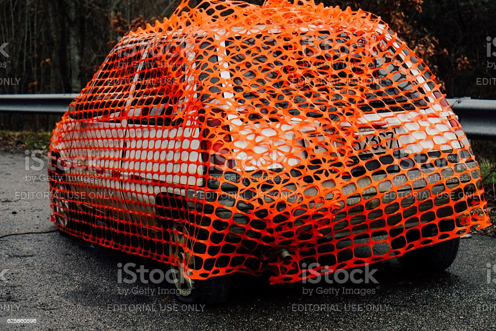 Vintage car covered on the street stock photo