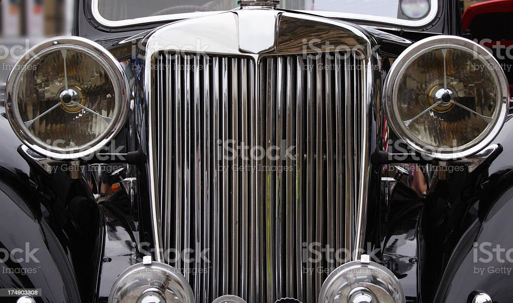 Vintage car grill and headlamps stock photo