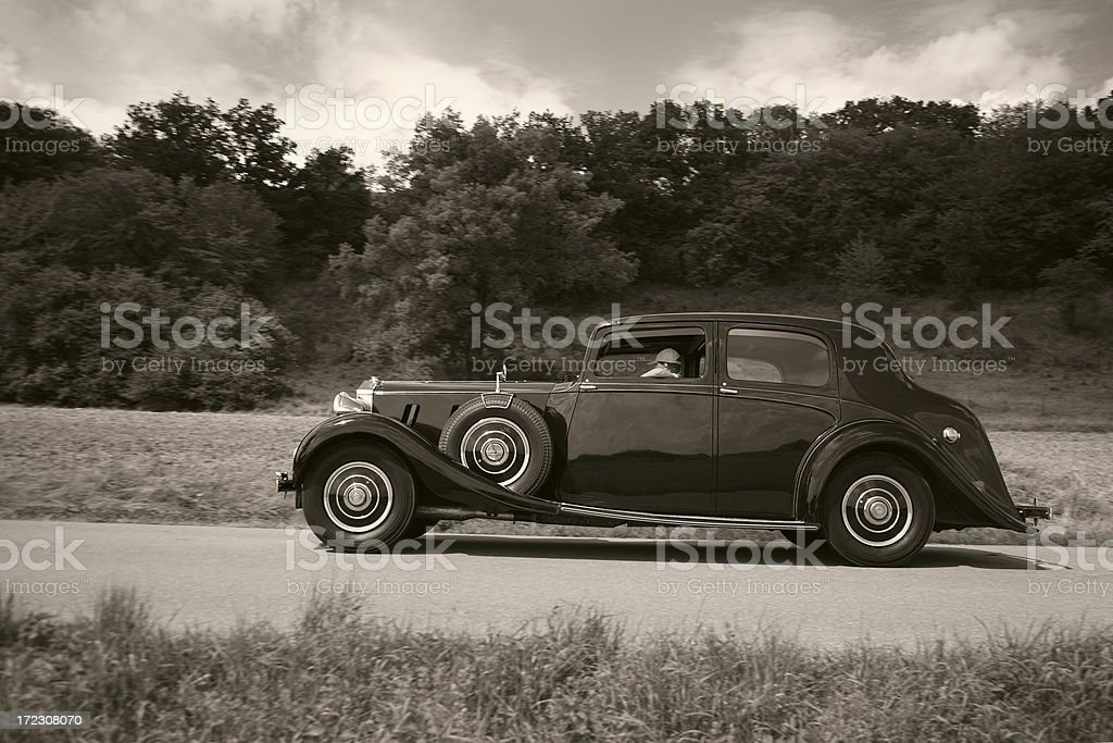 Vintage Car on a Country Road stock photo