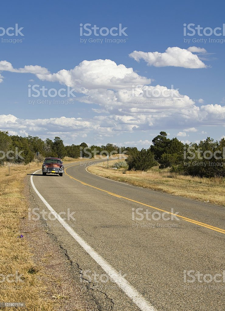 Vintage Car on Country Highway royalty-free stock photo