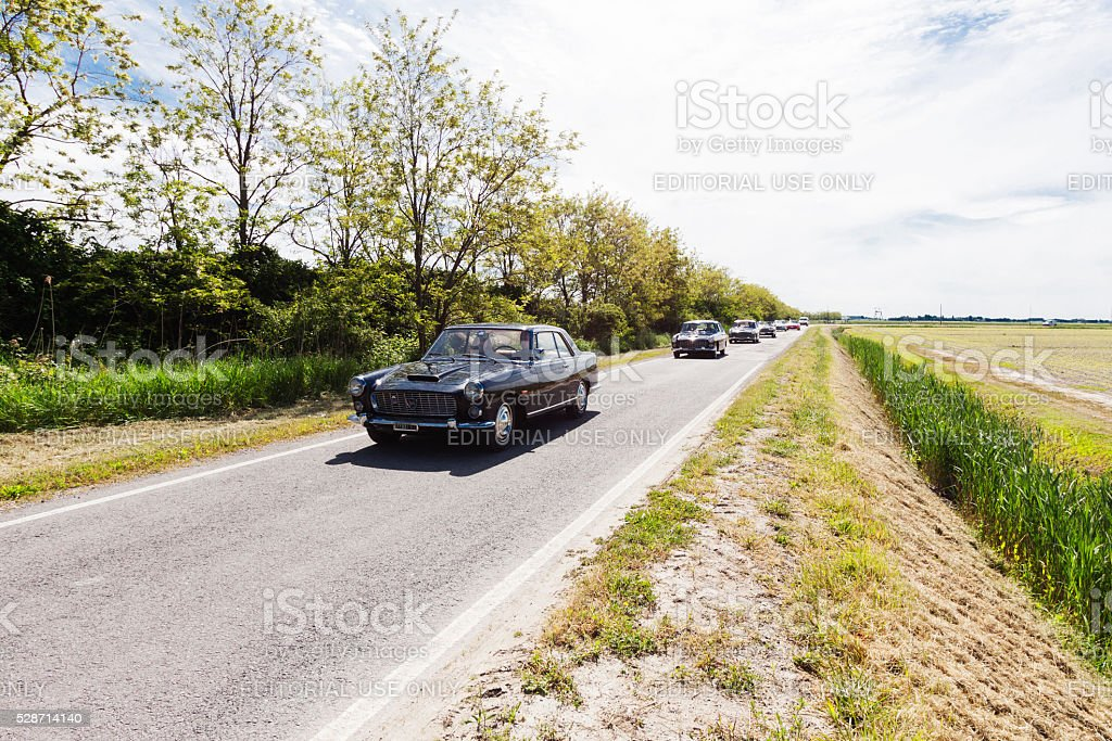 vintage car parade on the road in Italy stock photo
