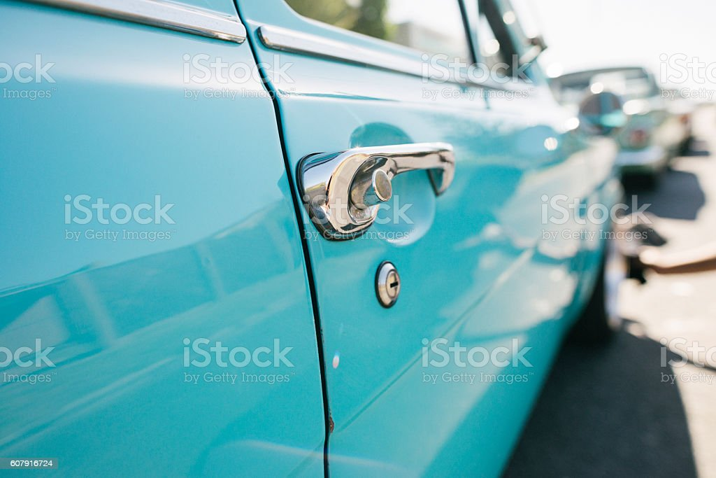 Vintage Car Parked In a Suburban Street stock photo