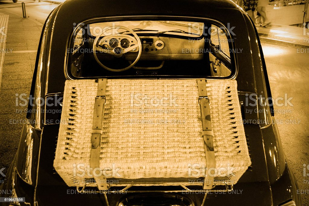 Vintage car with wicker suitcase stock photo