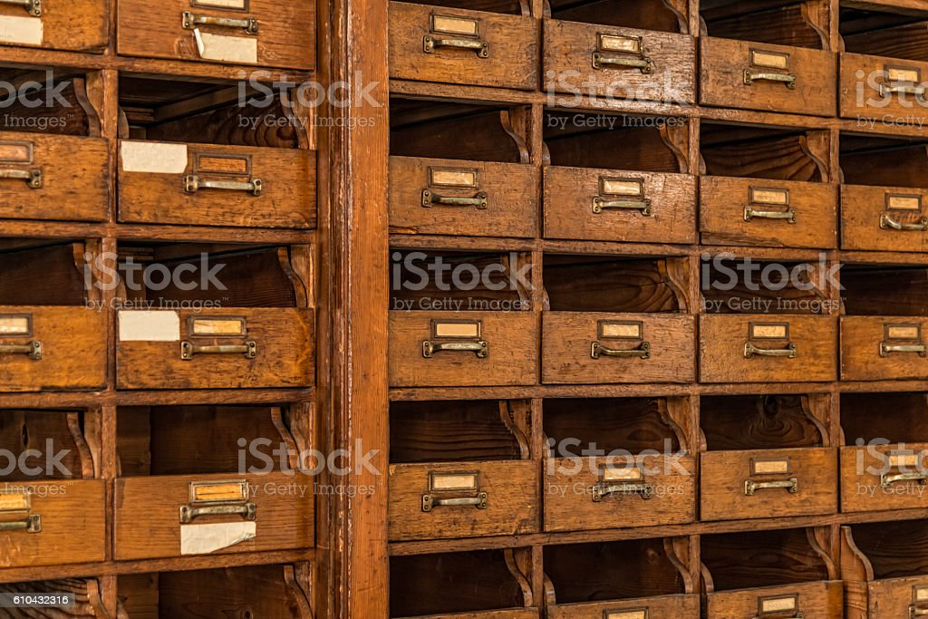 vintage card index cabinet - office archive stock photo