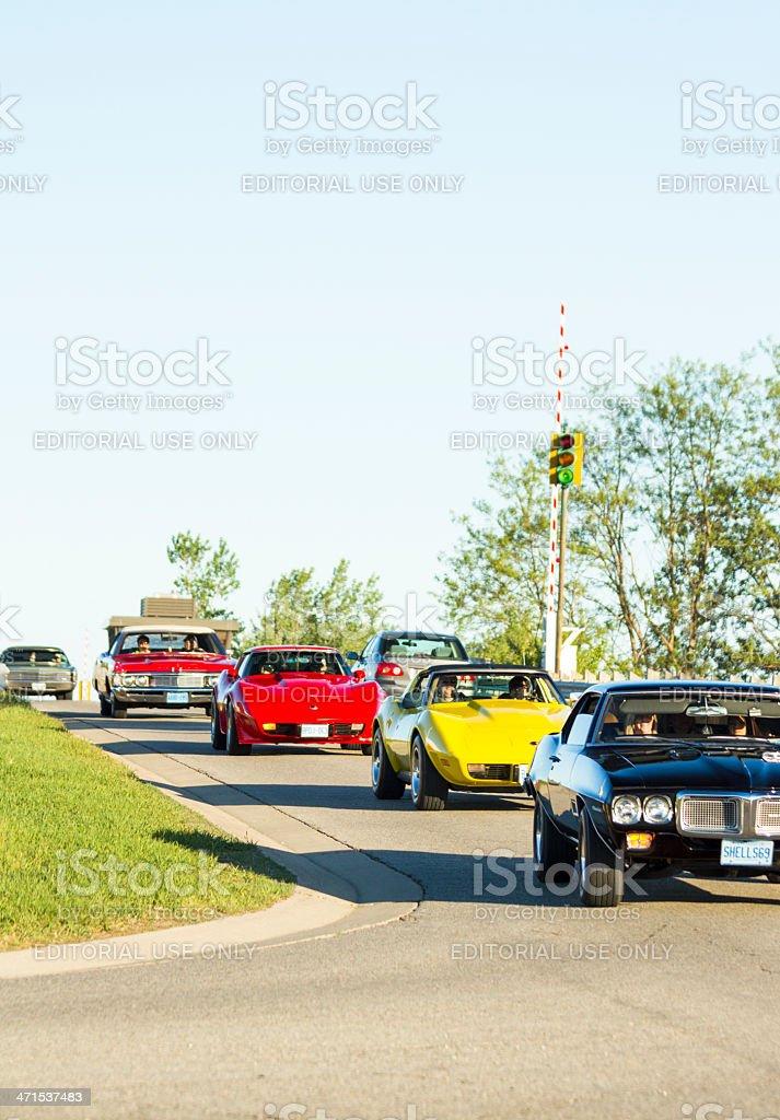 Vintage Cars Cross Bridge In Classic Car Cruise Parade stock photo