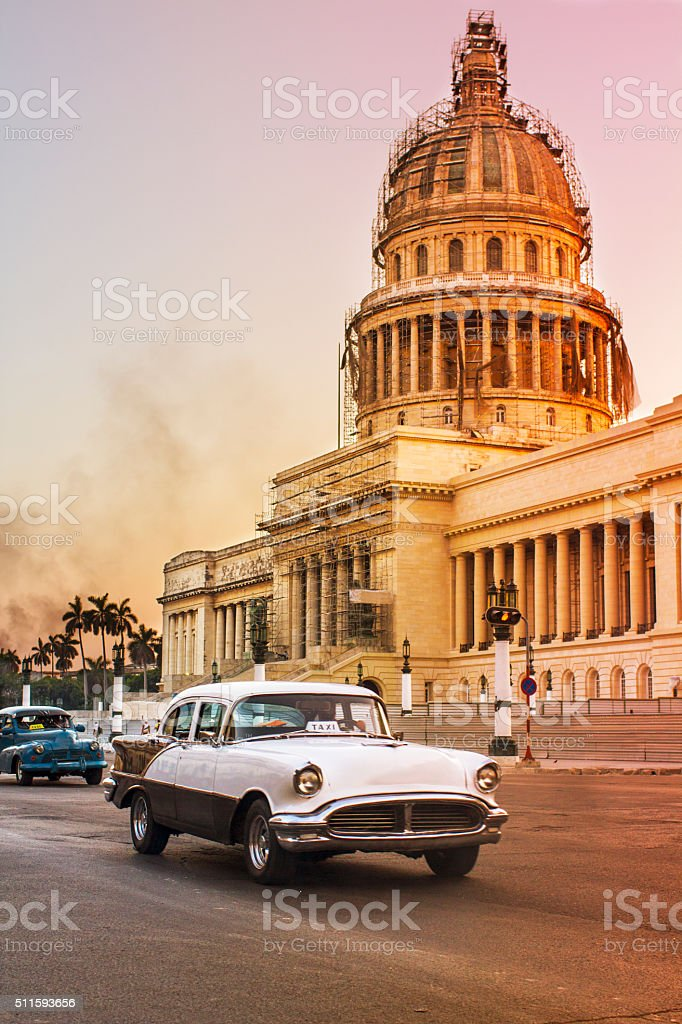 Vintage cars outside Capitolio at dusk stock photo