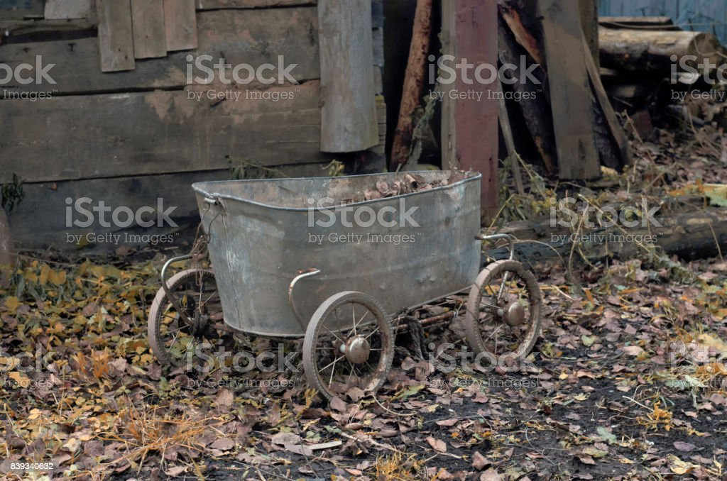 Vintage cart made from an old baby bath stock photo