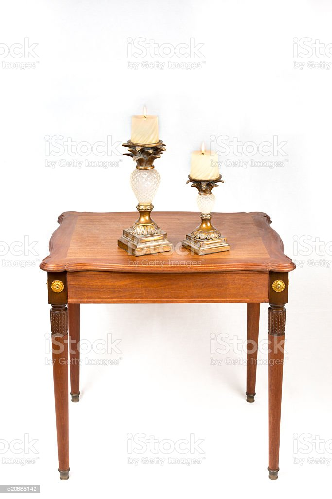 Vintage carved wood candle holders with burning candles stock photo