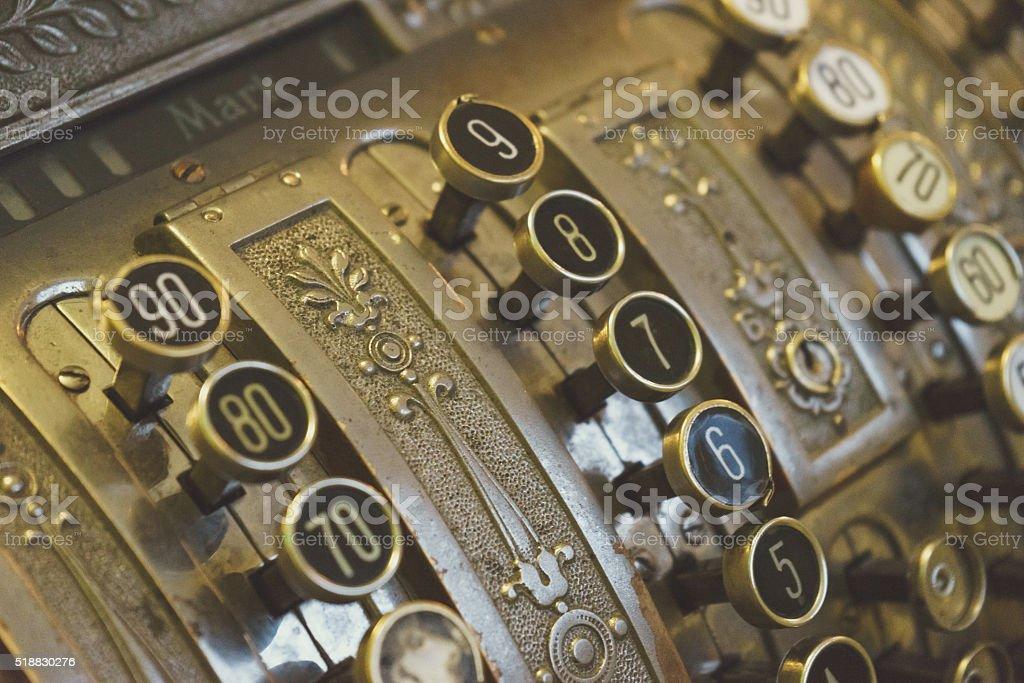 Vintage cash register keys closeup stock photo