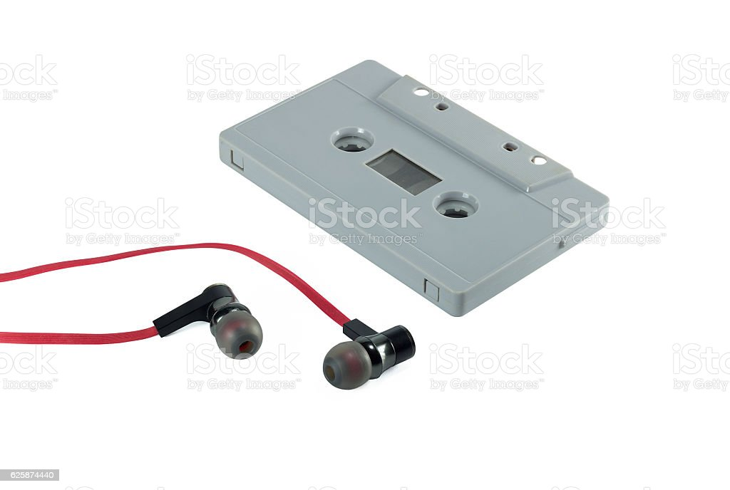 vintage cassette tape and red earphone isolate stock photo