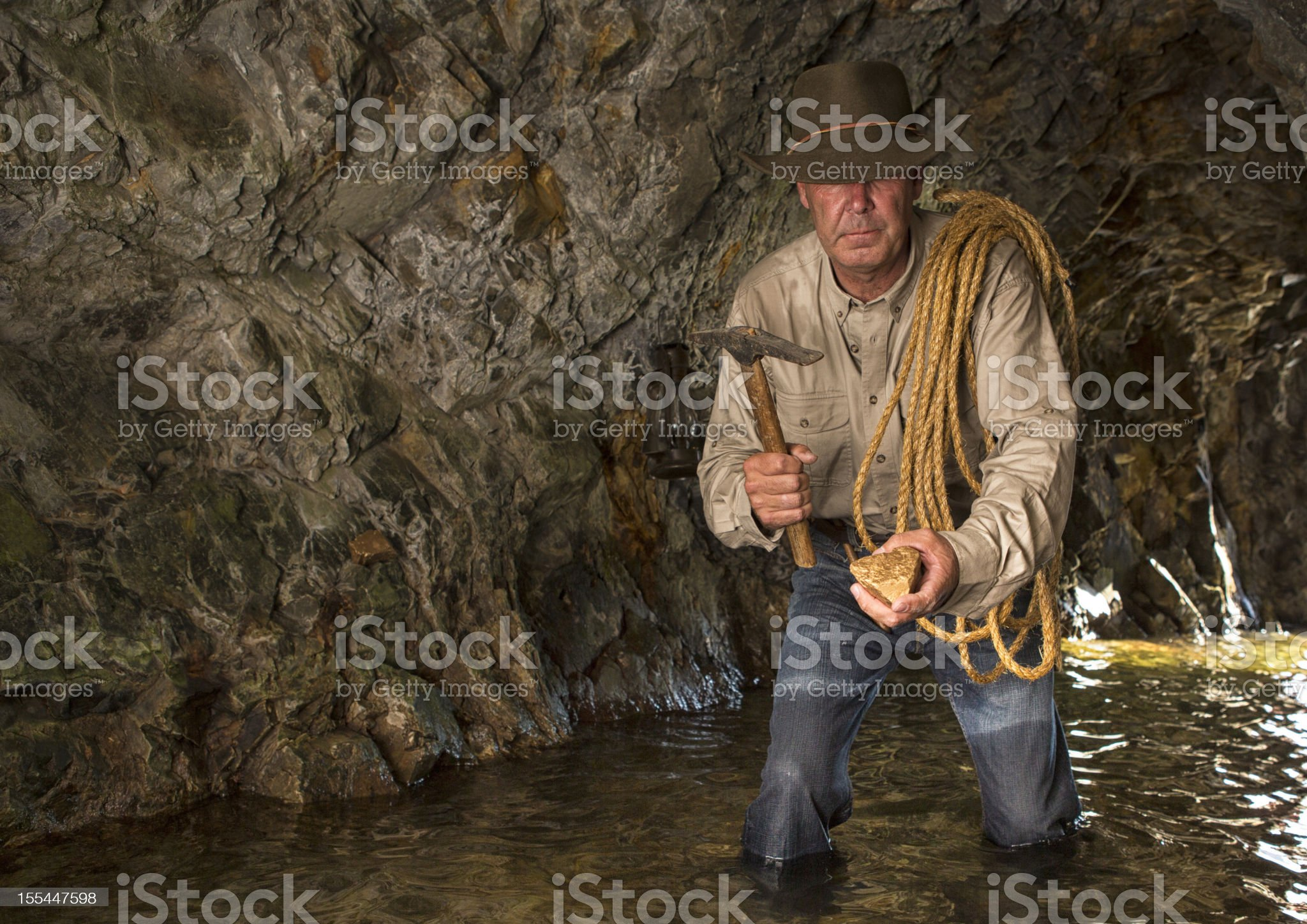 Vintage Cave Explorer Gold Mining royalty-free stock photo