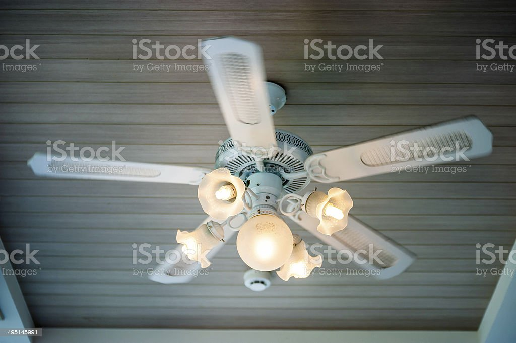 Vintage ceiling fan and lamp fixture in hotel stock photo