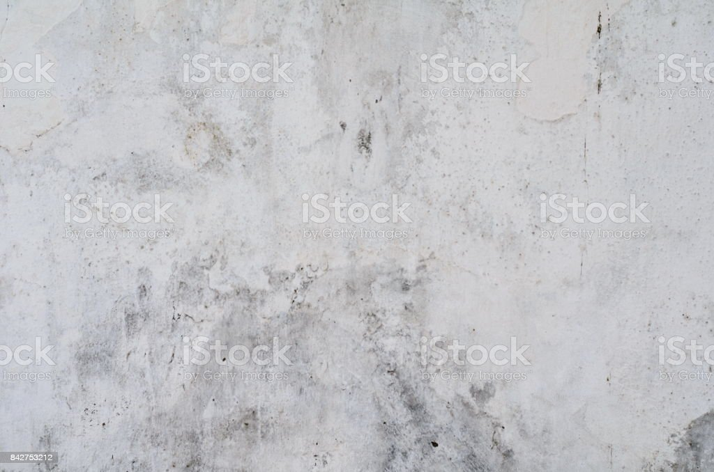 Vintage cement wall background with cracks and holes with many layers of paint stock photo