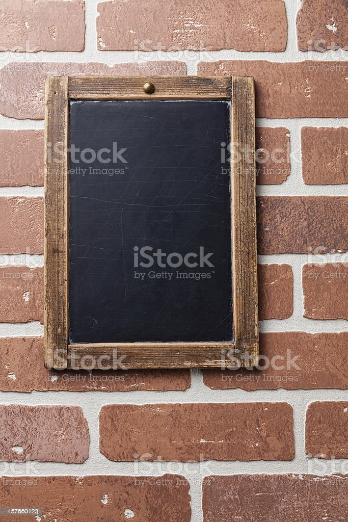 Vintage chalk board on red brick wall royalty-free stock photo