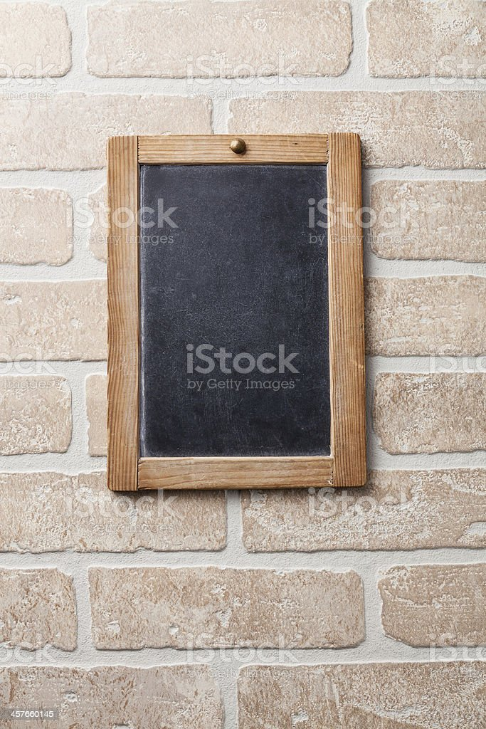 Vintage chalk board on white brick wall royalty-free stock photo