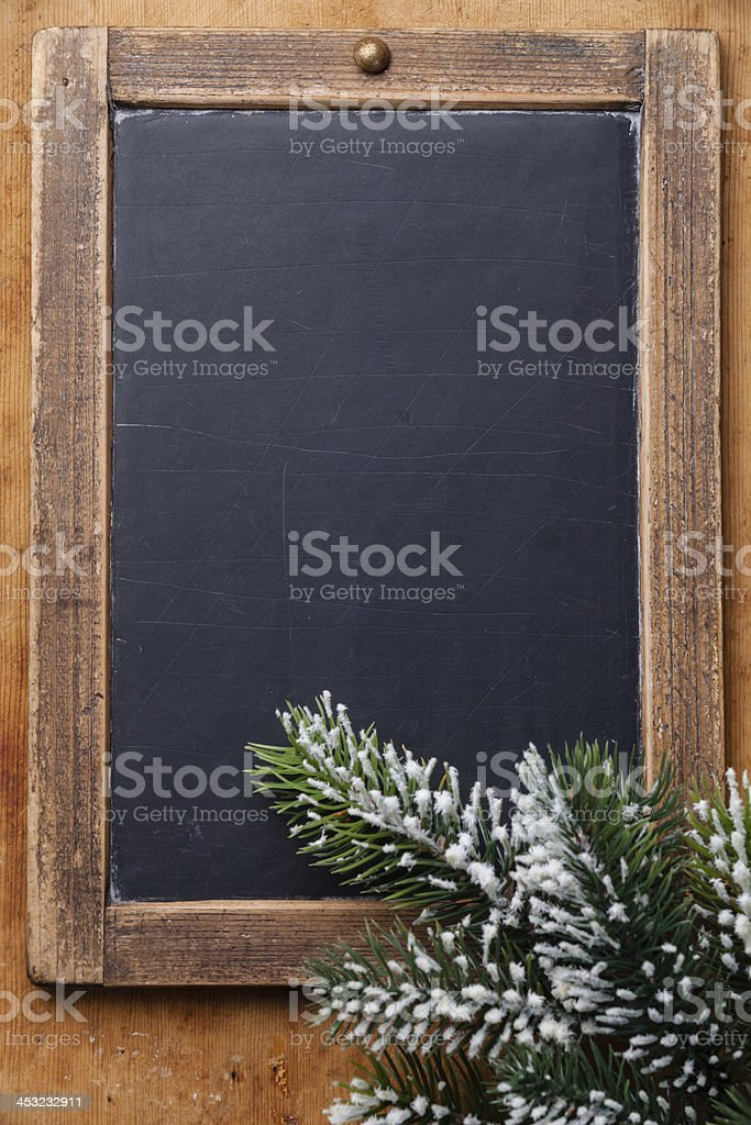 Vintage chalk board with Fir branch stock photo
