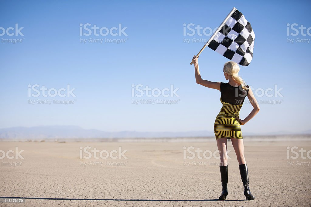 Vintage Checkered Flag Girl stock photo