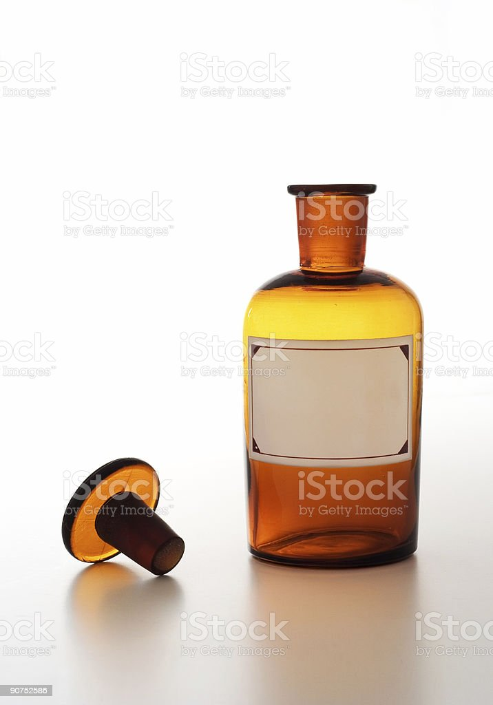 Vintage Chemical Bottle Isolated Over a White Background. stock photo