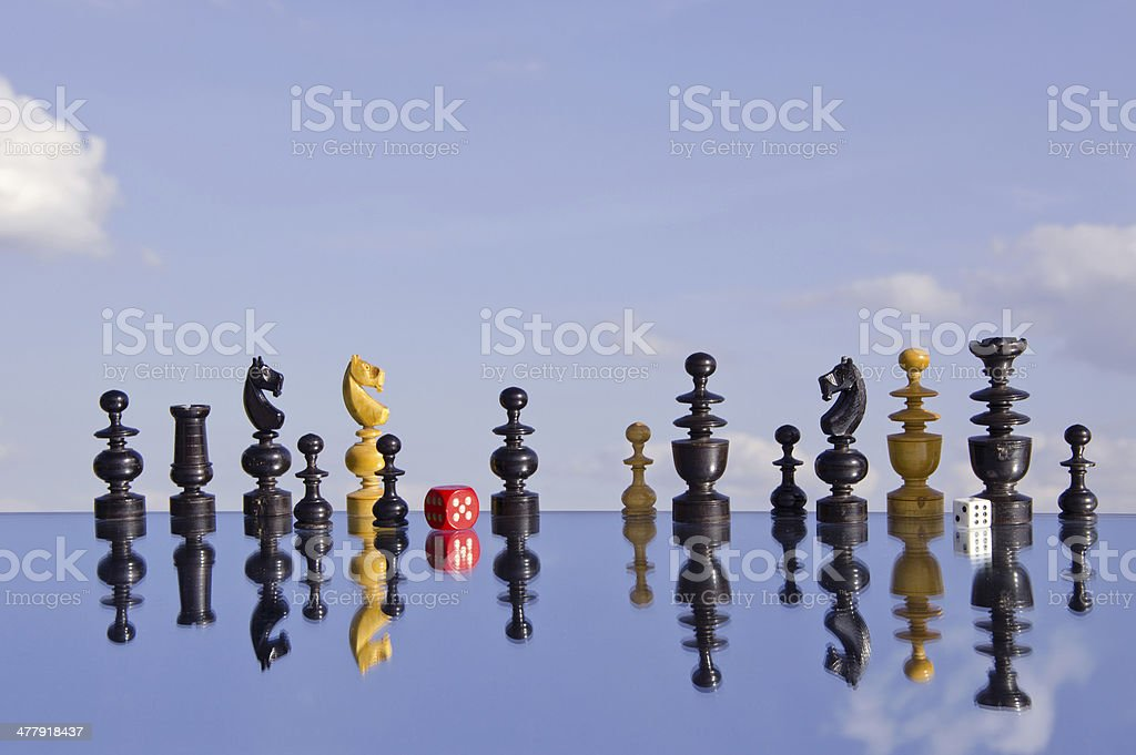 vintage chessmans  and red dice on mirror royalty-free stock photo