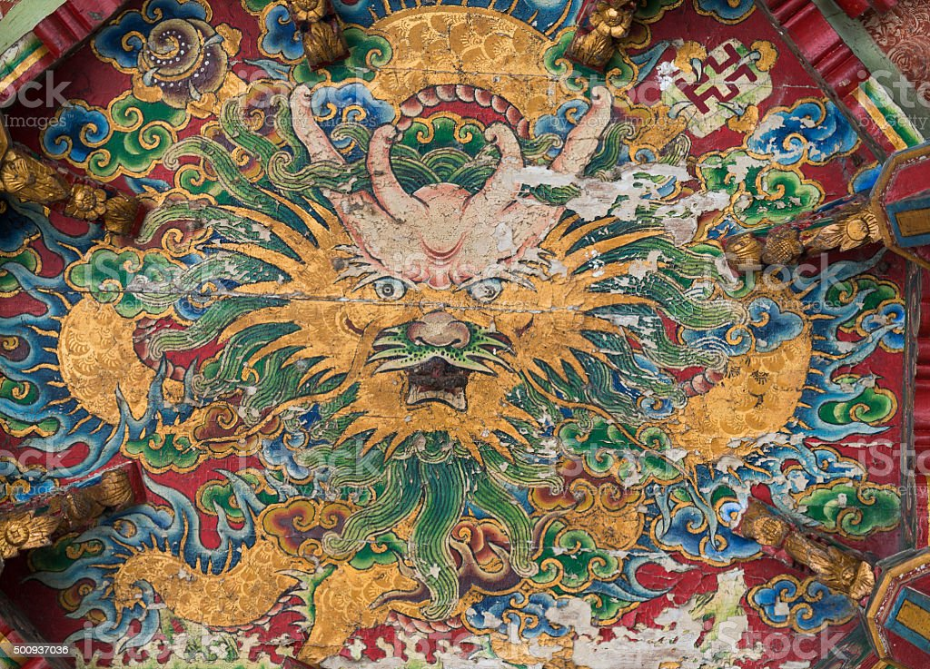 Vintage Chinese dragon painted on the ceiling of temple stock photo