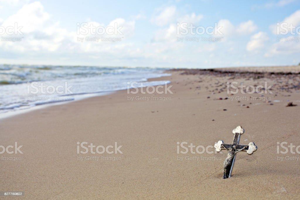 vintage christ cross on the sea waves stock photo