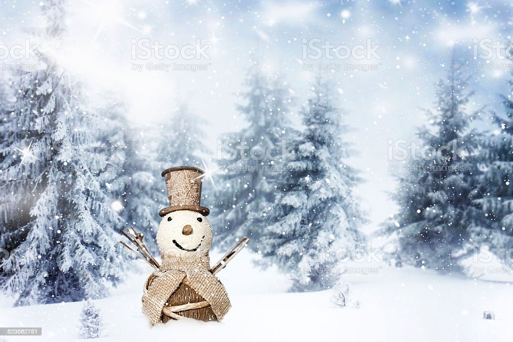 Vintage Christmas background with snowman on sunny day stock photo