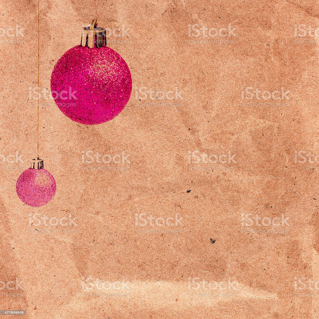 Vintage Christmas card with glittering balls on old recycled bro royalty-free stock photo